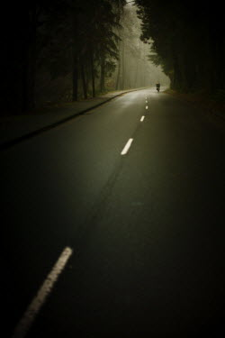 Romain Bayle CYCLIST ON DARK COUNTRY ROAD Roads