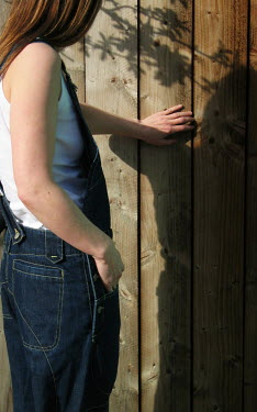 David Grogan WOMAN IN DUNGAREES BY WOODEN FENCE Women