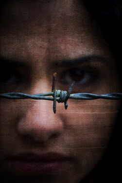 Mohamad Itani WOMANS FACE WITH BARBED WIRE FENCE Women