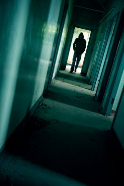 Andy & Michelle Kerry MAN WALKING IN CORRIDOR Men