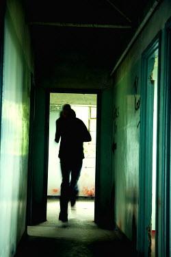 Andy & Michelle Kerry CRIMINAL MAN RUNNING IN CORRIDOR Men