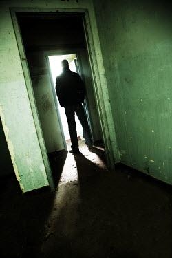 Andy & Michelle Kerry MAN STANDING AT DOORWAY Men