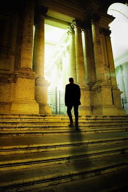 Yolande de Kort SILHOUETTE OF MAN ON BUILDINGS STEPS Men