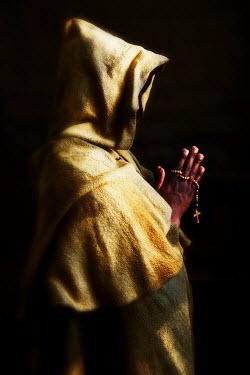 Ricardo Demurez HOODED MAN PRAYING WITH BEADS Men