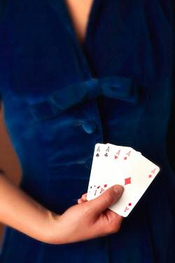 Ricardo Demurez WOMAN HOLDING PLAYING CARDS Women