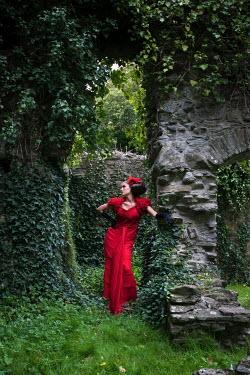 Rebecca Knowles WOMAN IN RED IN GARDEN Women