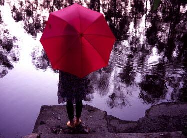 Kit Yip Woman by water Women