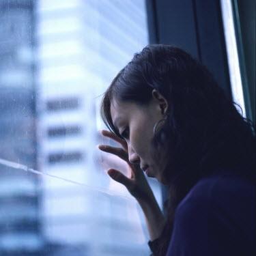 Kit Yip Woman looking out window Women