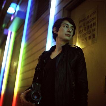 Kit Yip Man holding camera Men