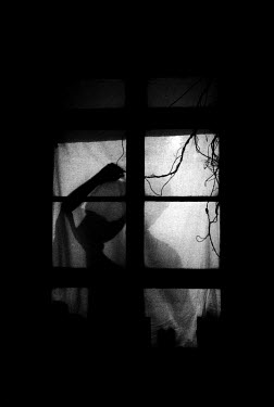 Denis Cohadon SILHOUETTE OF MAN IN WINDOW Couples