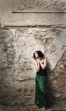 Steve Peet WOMAN BY DILAPIDATED WALL Women