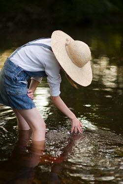 Lee Avison GIRL PLAYING IN STREAM Children