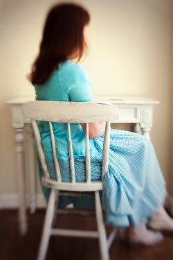 Susan Fox WOMAN SITTING ON CHAIR Women