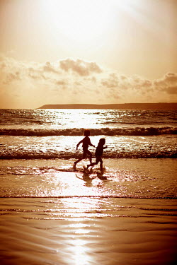Colin Hutton TWO CHILDREN PLAYING IN SEA Children