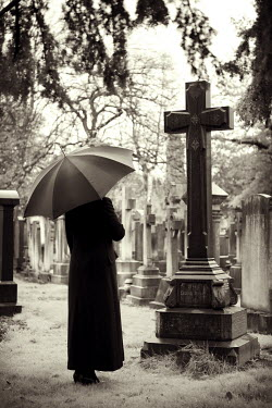 Lee Avison WOMAN WITH UMBRELLA IN GRAVEYARD Women