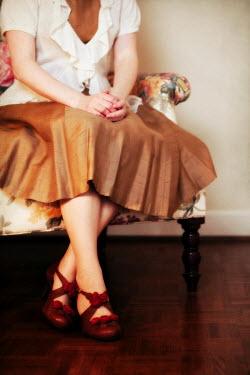 Susan Fox WOMAN SITTING IN ARMCHAIR Women
