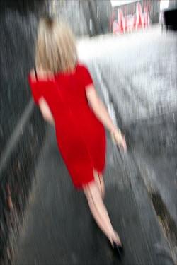David Gibson WOMAN IN RED WALKING IN STREET Women