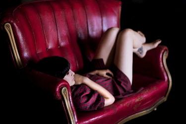 Lara Alegre WOMAN ON LUXURIOUS SOFA Women