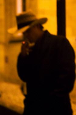 Stuart Brill MAN SMOKING IN COWBOY HAT Men