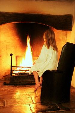 James Walker GIRL SITTING BY OPEN FIRE Children