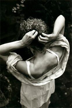 Daniel Murtagh WOMAN TYING UP HAIR Women