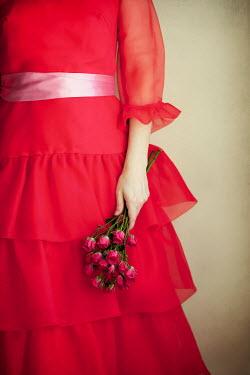 Susan Fox WOMAN IN RED HOLDING FLOWERS Women