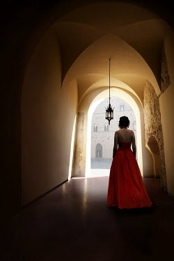 Yolande de Kort WOMAN IN RED GOWN UNDER LAMP IN HALLWAY Women