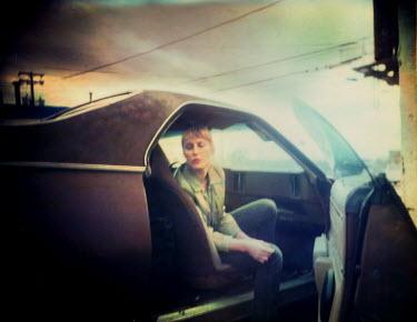 Gary Isaacs WOMAN SITTING IN RETRO CAR Women