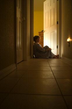 Terry Bidgood GIRL SAT IN CORRIDOR WITH NIGHTLIGHT Children