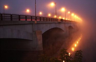 Terry Bidgood BRIDGE WITH LIGHTS REFLECTED IN WATER Bridges