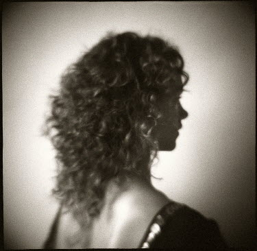 Christine Rodin WOMAN WITH CURLY HAIR LOOKING AWAY Women