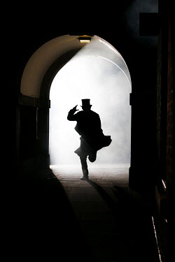 Neil Denham MAN IN SILHOUETTE RUNNING THROUGH TUNNEL Men