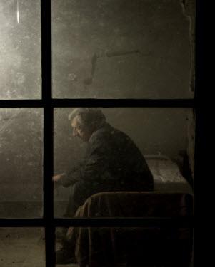Stephen Carroll OLD MAN SITTING ON BED Men