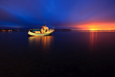 Mark Bauer MOORED BOAT WITH SUNSET Boats