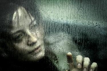 Stephen Carroll WOMAN STARES THROUGH RAIN SOAKED GLASS Women