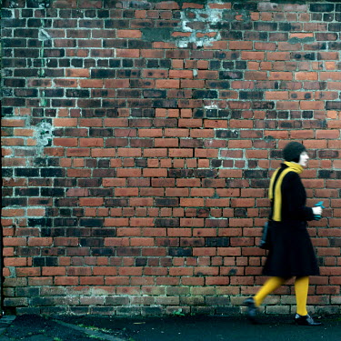 Myles Wickham WOMAN BY BRICK WALL Women