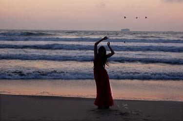 Daniel Murtagh WOMAN STOOD ON BEACH Women