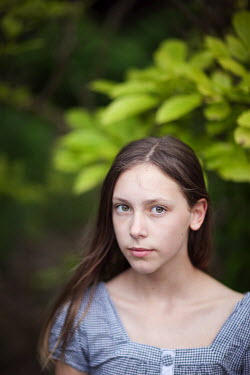Sarah Ketelaars young brunette girl beside green leaves Children