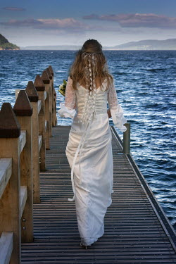 Colin Campbell WOMAN IN WEDDING DRESS WALKING ON PIER Women