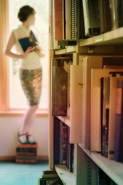 Marico Fayre WOMAN STANDING ON BOOKS Women