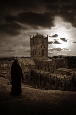 Dave Curtis WOMAN ON HILL LOOKING AT CHURCH Women