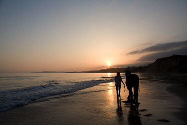 Nick Sokoloff SILHOUETTED WOMAN AND HORSE WALKING ON BEACH Women
