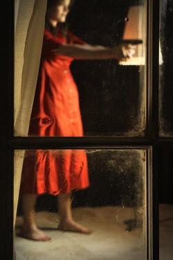 Stephen Carroll WOMAN POINTING GUN IN HOUSE Women