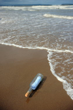 Clint Hughes MESSAGE IN A BOTTLE ON BEACH Miscellaneous Objects