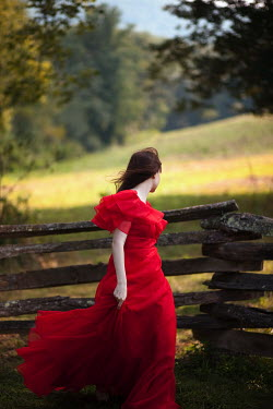 Susan Fox WOMAN IN FRONT OF WOODEN FENCE Women