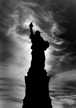 Andy Wilson STATUE OF LIBERTY IN SILHOUETTE Specific Cities/Towns