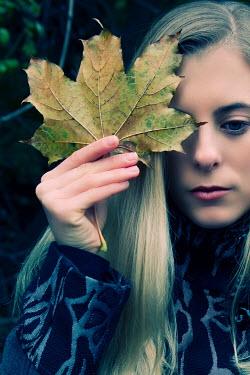 Tom Meadow blonde woman holding leaf Women