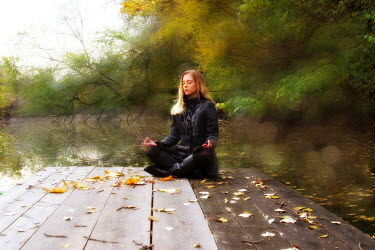 Tom Meadow blonde woman meditating by lake Women