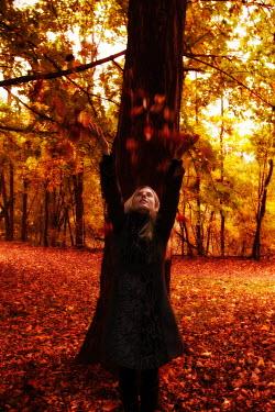 Tom Meadow Woman Throwing Leaves Women