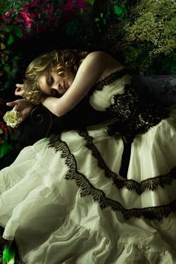 Dana France woman in ball gown sleeping in garden Women